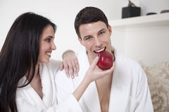young couple in the morning with an apple royalty free stock photos