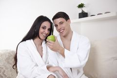 Sexy young couple in the morning with an apple Stock Image