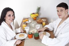 Sexy young couple in the morning having breakfast Stock Images
