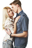 Sexy young couple. Wearing jeans in the studio Royalty Free Stock Image