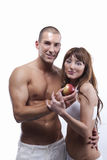 Sexy young couple in white, with apple Stock Photos