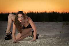 Sexy young curly woman Stock Image