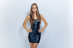 Sexy young fashion girl in black mini dress Royalty Free Stock Photo