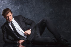 Sexy young fashion man lying down Royalty Free Stock Photo