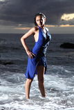 young fashion model in the sea with dress Royalty Free Stock Photo