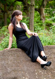 Sexy young female in black dress outdoors Royalty Free Stock Image