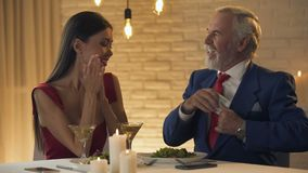 Young female demanding money from old husband, marriage of convenience. Stock footage stock footage