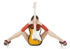 Sexy young female posing with guitar Royalty Free Stock Image