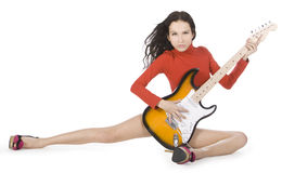 Sexy young female posing with guitar Royalty Free Stock Images