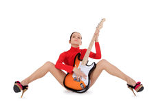 Sexy young female posing with guitar over white Royalty Free Stock Images