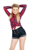Sexy young female in shorts and shirt Royalty Free Stock Photography