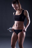 Sexy young fit woman lifting dumbell Stock Images