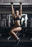 Sexy young fitness girl pulls up in the gym Royalty Free Stock Photo