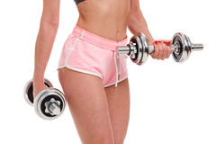 young fitness woman doing workout with dumbbells stock photos