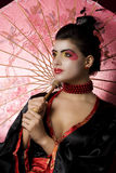 Sexy young geisha holding an umbrella Stock Photography