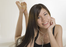 Sexy young girl. Beautiful sexy young Asian girl listening to music Stock Photography