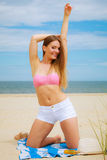 Sexy young girl on beach. Sun protection concept. Attractive sexy long haired woman on beach with sunscreen body lotion Royalty Free Stock Photos