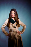 Sexy young girl in beige autumn coat Stock Photography