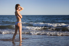 Sexy young girl in bikini. On the beach Royalty Free Stock Images