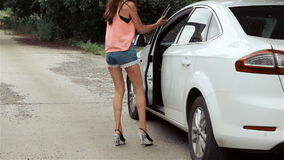 Sexy young girl closes the hood stock footage