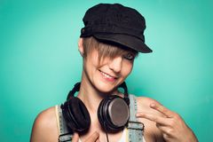 young girl with headphones looking at the camera and smiling. royalty free stock photos