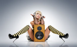 young girl in headphones with speaker