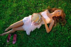 Sexy young girl lying down on grass Stock Image