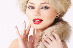 Sexy young girl is posing. Sexy young girl in fur hat is posing Royalty Free Stock Photography