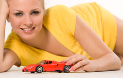 Sexy young girl with red car. Sexy young girl with red toy car Stock Photography