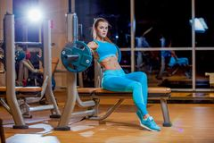 young girl resting after exercises. Fitness brunette woman royalty free stock image