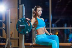 young girl resting after exercises. Fitness brunette woman royalty free stock photo