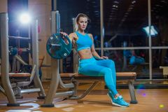 young girl resting after exercises. Fitness brunette woman stock photos