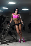 young girl resting after training. Fitness woman in sport w Royalty Free Stock Photos