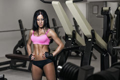 Sexy young girl resting after training in gym Royalty Free Stock Photography