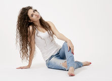Sexy young girl in shirt and torn jeans Royalty Free Stock Images