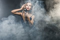 young girl singer singing with silver retro microphone royalty free stock photography