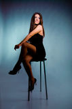 Sexy young girl sitting on chair Stock Photo