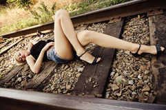 Sexy young girl sleeping on rails Royalty Free Stock Images