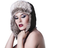 Sexy young girl with snow hat, isolated on white Royalty Free Stock Photography