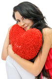Sexy young girl with toy-heart Stock Photo