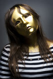 young girl with venetian mask Royalty Free Stock Images
