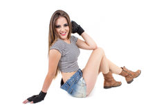 Sexy young girl wearing denim shorts posing Royalty Free Stock Images