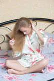 Sexy Young Girl Wearing White Nightdress Combing Stock Images
