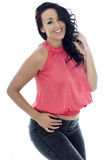 Sexy Young Hispanic Woman Posing In A Pink Top and Black Jeans Royalty Free Stock Photography