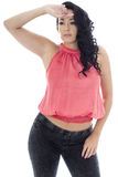 Sexy Young Hispanic Woman Posing In A Pink Top and Black Jeans Royalty Free Stock Photo