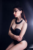 Sexy young lady in bunny ears mask and black body Royalty Free Stock Image