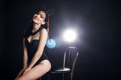 Sexy young lady in bunny ears mask and black body Royalty Free Stock Images