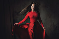 young lady in fluttering red dress Royalty Free Stock Photography