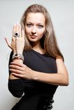 Sexy young lady showing her jewelery Royalty Free Stock Images