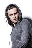 Young man. In a gray sweater on a white background Stock Images